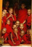 Buddhist monks watching dancing at a festival, Lingshed, Zanskar, India Himalaya