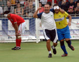 A Brazilian coach celebrates with one of the players after beating England in the Blind Football World Cup.