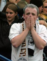 A Hereford United supporter tries to contain his emotions.