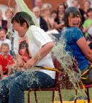 Two women get a soaking at a school fete.