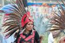 Serious female Aztec dancer
