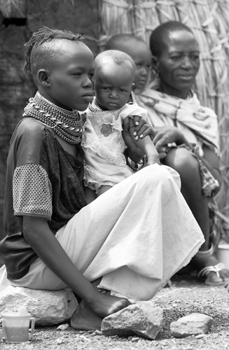 El Molo girl sitting, Kenya