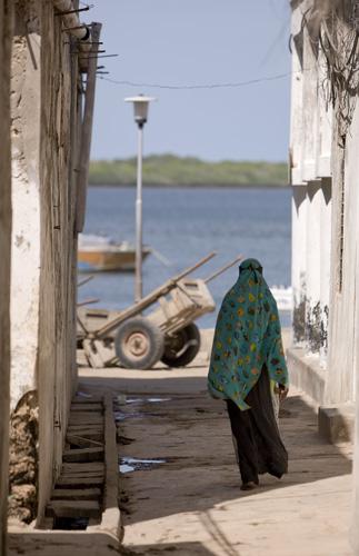 Woman Walking Through Lamu Alley, Kenya
