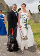 The bride and groom with their dogs.