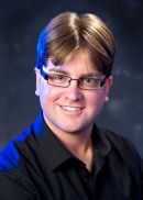 Sean Corlett, portrait in blue.