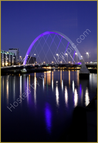 The Squinty Bridge and lights reflected in the River Clyde