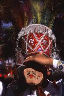 Masked chuncho dancer