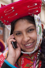 Girl in traditional dress using cellphone