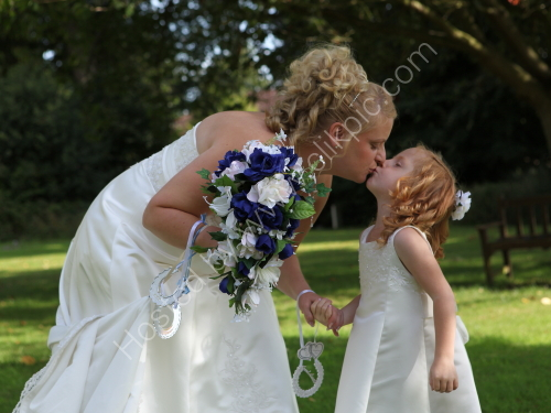 Tara kissing a young bridesmaid - from Tara &amp; Paul's wedding at Bishopstoke.
