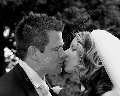 Lara & Jamie - The Kiss - Wedding @ the Moorhill House Burley